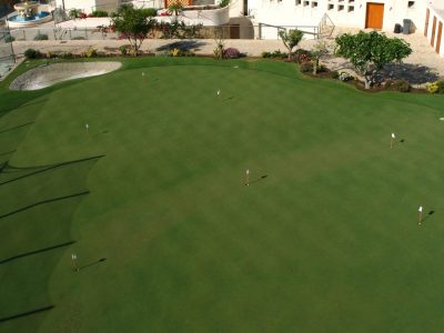 Tennis court and putting green